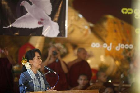 Myanmar's pro-democracy leader Aung San Suu Kyi speaks at a ceremony, to mark the 20th anniversary of her receiving the Noble Peace Prize, at a monastery in Yangon December 10, 2011. REUTERS/Soe Zeya Tun