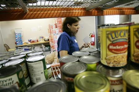 Volunteer Charlene Bennett fills an order at the North Fulton Community Charities food bank in Alpharetta, Georgia in this picture taken June 4, 2008.  REUTERS/Tami Chappell