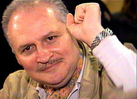 Ilich Ramirez Sanchez, better known as ''Carlos the Jackal'', raises his fist as he appears in court in Paris November 28, 2000 coinciding with a trial in Frankfurt of his former German accomplice Hans-Joachim Klein.  REUTERS/RTV/Thierry Chiarello