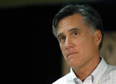 Republican presidential candidate and former Massachusetts Governor Mitt Romney listens to a question from the audience at a ''We the People Freedom Forum'' in Hudson, New Hampshire December 11, 2011.   REUTERS/Brian Snyder