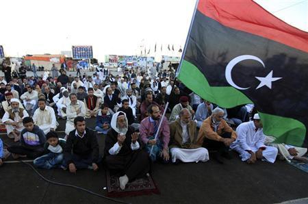 Muslims attend the Eid al-Adha prayers, the first after former Libyan leader Muammar Gaddafi was killed, near the court house in Benghazi November 6, 2011. REUTERS/Esam Al-Fetori