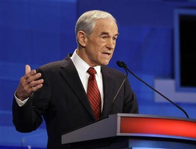 Republican presidential candidate U.S. Representative Ron Paul (R-TX) speaks during the Republican Party presidential candidates debate in Sioux City, Iowa, December 15, 2011. REUTERS/Eric Gay/Pool
