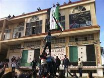 Demonstrators against Syria's President Bashar al-Assad gather in Homs December 13, 2011.  REUTERS/Handout