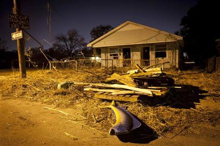 Debris, including a stuffed fish, sits in front of a blighted house in the Lower Ninth Ward of New Orleans, December 1, 2011. REUTERS-Lee Celano