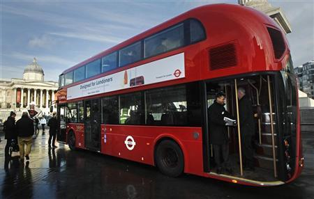 People look at the new style London bus after its launch at Trafalgar Square in London December 16, 2011. The more environmentally friendly bus is based on the popular old Routemaster design and will enter service at the beginning of next year.  REUTERS/Luke MacGregor