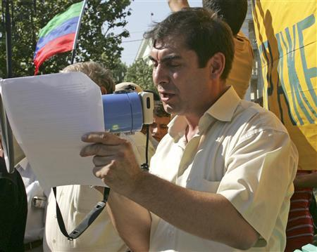 Journalist Gadzhimurat Kamalov attends an opposition protest in the Dagestani capital Makhachkala in this August 29, 2008 file photo. Kamalov, the founder of newspaper Chernovik that investigated government corruption, was shot dead shortly before midnight on December 15, 2011 in Russia's North Caucasus region, in what an international watchdog called ''a lethal blow to press freedom.'' REUTERS/Lekai Dmitri/Files