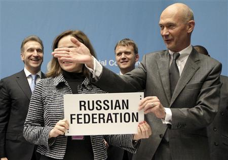 WTO Director general Pascal Lamy (R) gestures next to Elvira Nabiullina, Minister of Economic Development and Igor Shuvalov, Russia Deputy Prime Minster of Russia after the signature of the accession of the Russian Fedration as WTO member in Geneva December 16, 2011.  REUTERS/Denis Balibouse