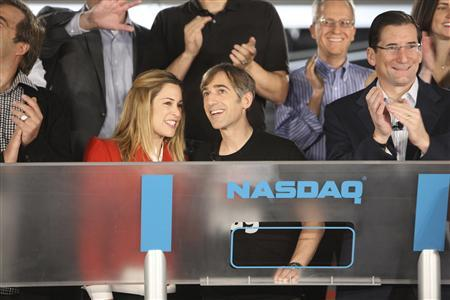 Zynga CEO Mark Pincus and his wife Ali are shown after Pincus rung the opening bell of the NASDAQ exchange remotely from Zynga's headquarters on the day of the company's IPO in San Francisco, December 16, 2011.        REUTERS/Zef Nikolla/NASDAQ