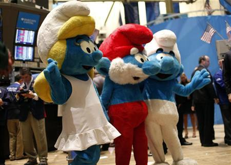 Costumed ''Smurfs'' characters wave on the main trading floor of the New York Stock Exchange, after ringing the opening bell for the Exchange's session July 29, 2011. The new comedy movie ''The Smurfs'' opens July 29 in U.S. theaters.  REUTERS/Mike Segar