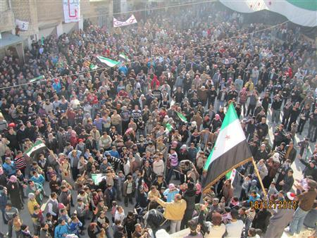 Demonstrators protesting against Syria's President Bashar al-Assad gather during a march through the streets after Friday prayers in Ma'arrat al-Numan near Adlb December 16, 2011. REUTERS/Handout