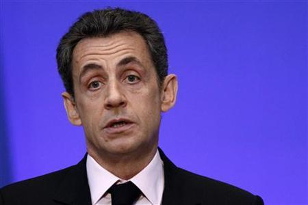 France's President Nicolas Sarkozy delivers a speech during the first meeting of accredited professionals at the French Economic, Social and Environmental Council (CESE) in Paris December 12, 2011. REUTERS/Jacky Naegelen