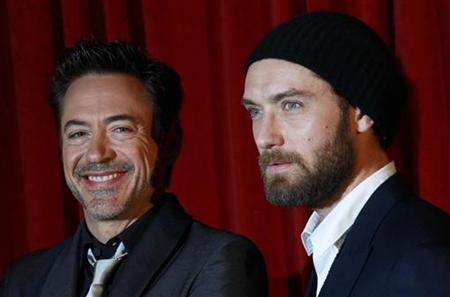 U.S. actor Robert Downey Jr. and British actor Jude Law pose for photographers at the premiere of ''Sherlock Holmes: A Game of Shadows'' at the Empire Cinema in London December 8, 2011. REUTERS/Suzanne Plunkett