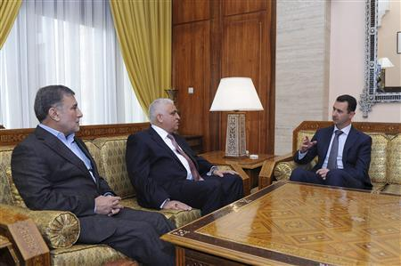 Syria's President Bashar al-Assad (R) meets with envoys of Iraqi Prime Minister Nuri al-Maliki, National Security Adviser Faleh al-Fayad  (C),and MP Ezzat al-Shahbandar (L) in Damascus December 17, 2011, in this handout photograph released by Syria's national news agency SANA .REUTERS/SANA/Handout