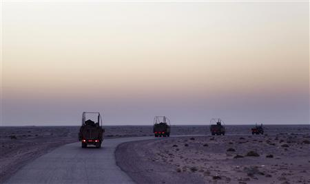 A line of Mine Resistant Ambush Protected (MRAP) vehicles from the 3rd Brigade Combat Team, 1st Cavalry Division that are part of the last U.S. military convoy to leave Iraq drive south on Highway 1 towards Kuwait December 18, 2011. REUTERS/Lucas Jackson