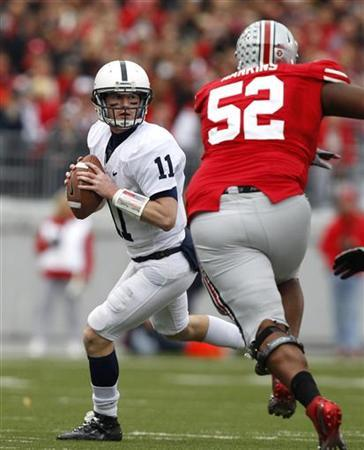Penn State quarterback Matt McGloin (11) looks for a receiver as he is pressured by Ohio State defensive lineman Johnathan Hankins during the third quarter of their NCAA football game in Columbus, Ohio, November 19, 2011.    REUTERS/Matt Sullivan