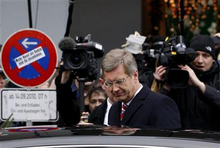 German President Christian Wulff leaves after a religious service to mark the 50th anniversary of the Kaiser-Wilhelm-Gedaechtnis-Kirche (Emperor Wilhelm Memorial Church) in Berlin December 18, 2011. REUTERS/Tobias Schwarz
