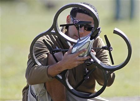 A technician supporting U.S. Navy SEAL Team 18 works on a UAV, an unmanned aerial vehicle, before a demonstration of combat skills at the National Navy UDT-SEAL Museum in Fort Pierce, Florida November 11, 2011. REUTERS/Joe Skipper