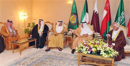Saudi Arabia's Foreign Minister Prince Saud al-Faisal (L), Bahrain's Foreign Minister Sheikh Khaled bin Ahmed al-Khalifa, (2-L) United Arab Emirates' Foreign Minister Sheikh Abdullah bin Zayed al-Nahyanat (C),  Qatar's Prime Minister Sheikh Hamad bin Jassim bin Jaber al-Thani (2-R) and Oman's Foreign Minister Youssef bin Alawi bin Abdullah,(R) talk before the Gulf Cooperation Council (GCC) meeting in Riyadh December 18, 2011.