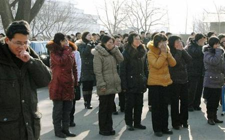 Pyongyang residents react as they mourn over the death of North Korean leader Kim Jong-il in Pyongyang, in this photo taken by Kyodo on December 19, 2011. REUTERS/Kyodo