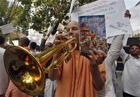 A member of the global Hare Krishna sect plays a trumpet during a protest outside the Russian consulate in Kolkata December 19, 2011. REUTERS/Rupak De Chowdhuri