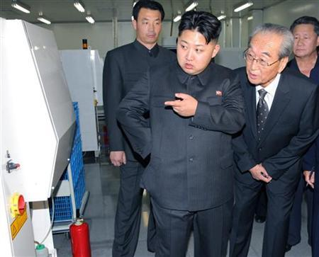 Kim Jong-un (C), son of North Korean leader Kim Jong-il (not pictured) visits Mokran Video Company in Pyongyang in this undated picture released by the North's official KCNA news agency September 11, 2011. KCNA did not state precisely when the picture was taken. REUTERS/KCNA