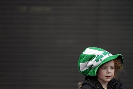 A young girl watches the annual St. Patrick's Day parade in Belfast, Northern Ireland March 17, 2011. REUTERS/Cathal McNaughton