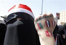 "An anti-government protester displays paintings on her hand of other countries involved in the Arab Spring revolutions during a rally to demand the ouster of Yemen's President Ali Abdullah Saleh in Sanaa October 26, 2011. The words read, ""Go out."" REUTERS/Louafi Larbi"