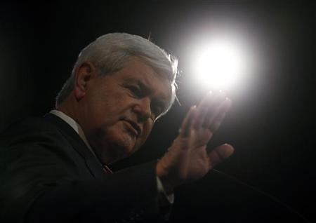 Republican presidential candidate and former Speaker of the House Newt Gingrich gestures as he speaks at ''The Gift of Life'' movie premiere in Des Moines, Iowa, December 14, 2011.  REUTERS/Jim Young
