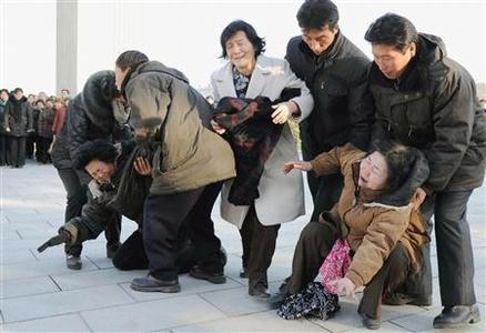 Pyongyang residents react as they mourn the death of North Korean leader Kim Jong-il in Pyongyang, in this photo taken by Kyodo on December 19, 2011.  REUTERS/Kyodo