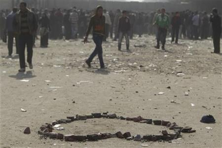 Stones thrown during clashes between army soldiers and protesters are placed in a heart-shape around blood stains, in memory of protesters killed during clashes near the cabinet at Tahrir Square in Cairo December 19, 2011. REUTERS/Amr Abdallah Dalsh