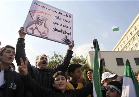 Syrians living in Egypt shout slogans against Syrian President Bashar al-Assad during a protest outside the Arab League offices in Cairo December 15, 2011. REUTERS/Amr Abdallah Dalsh