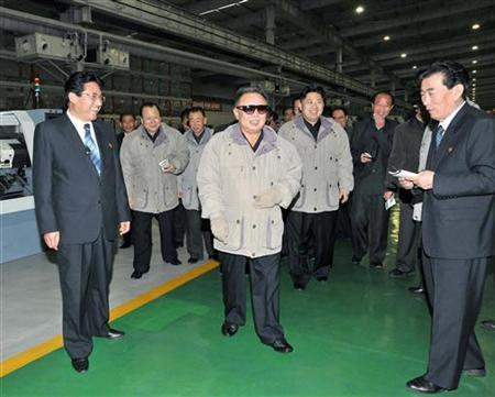 North Korean leader Kim Jong-il (C) and his son Kim Jong-un (1st R from Kim Jong-il) visit the Huichon Ryonha General Machinery Plant in North Korea, in this undated picture released by North Korea's official news agency KCNA on October 31, 2011. REUTERS/KCNA