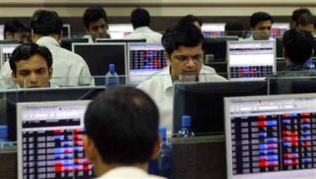 Brokers trade on their computer terminals at a stock brokerage firm in Mumbai July 23, 2008. REUTERS/Punit Paranjpe/Files