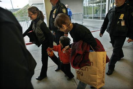U.S. citizen Lori Berenson (L) and her son Salvador Apari walk with Lori's mother Rhoda Berenson after arriving at Newark Liberty international airport in New Jersey December 20, 2011.  REUTERS/Eduardo Munoz