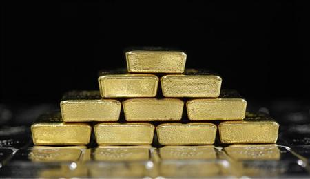 Gold and silver bars are pictured at the Austrian Gold and Silver Separating Plant 'Oegussa' in Vienna August 26, 2011. REUTERS/Lisi Niesner