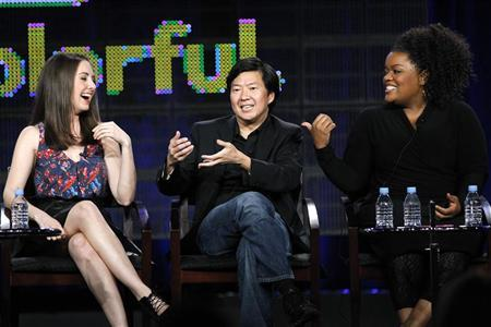 Cast member Ken Jeong (C) answers a question, as co-stars Alison Brie (L) and Yvette Nicole Brown laugh, at the NBC panel for the television series ''Community'' during the Television Critics Association winter press tour in Pasadena, California January 13, 2011.  REUTERS/Mario Anzuoni