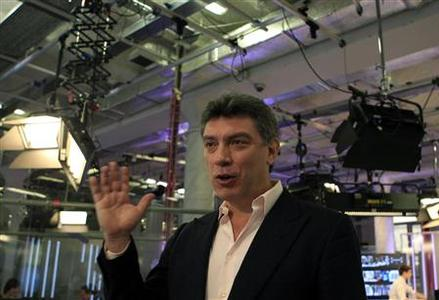 Russian opposition leader Boris Nemtsov gestures during a television interview in Moscow December 20, 2011.  REUTERS/Grigory Dukor