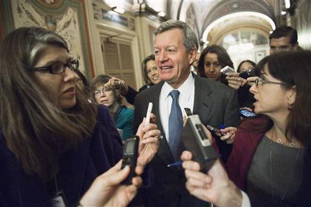 U.S. Senator Max Baucus (D-MT) (C) talks to reporters after meeting with his fellow Democratic members of the 'super committee' at the U.S. Capitol in Washington November 16, 2011. REUTERS/Jonathan Ernst