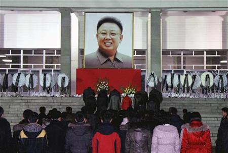 North Koreans make a call of condolence for deceased leader Kim Jong-il in Pyongyang in this picture released by the North's official KCNA news agency early December 21, 2011. REUTERS/KCNA
