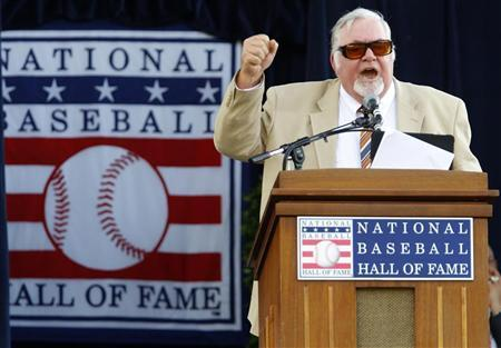 Sportswriter Bill Conlin of the Philadelphia Daily News speaks after being honored with the J.G. Taylor Spink Award for Journalists for his more than 45 years of baseball coverage at the National Baseball Hall of Fame in Cooperstown, New York, July 23, 2011. REUTERS/Mike Segar