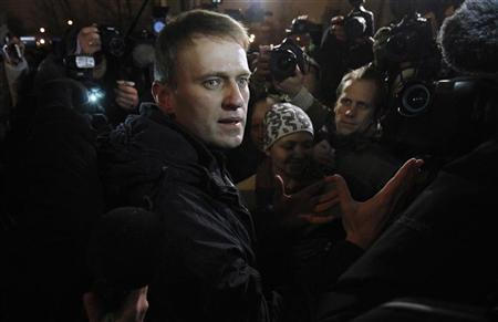 Anti-corruption blogger Alexei Navalny speaks with journalists as he leaves a police station on the day of his discharge in Moscow, December 21, 2011. Navalny was arrested at an opposition protest in Moscow on December 5. REUTERS/Denis Sinyakov