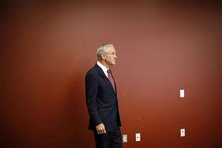 Republican presidential candidate and Congressman Ron Paul listens to his introduction at a town hall meeting with employees of Nationwide/Allied Insurance in Des Moines, Iowa, November 4, 2011.  REUTERS/Jim Young