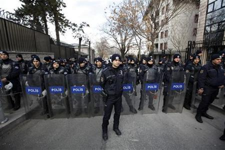 Turkish riot police block a road leading to the French Embassy in Ankara, during a demonstration by protesters against a proposed French draft law making it illegal to deny the 1915 mass killing of Armenians in the Ottoman Empire was genocide, December 16, 2011. REUTERS/Umit Bektas