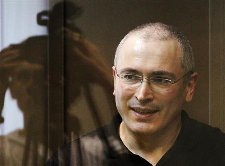Jailed Russian ex-tycoon Mikhail Khodorkovsky stands in the defendant's box during a court session in Moscow May 24, 2011. REUTERS/Denis Sinyakov