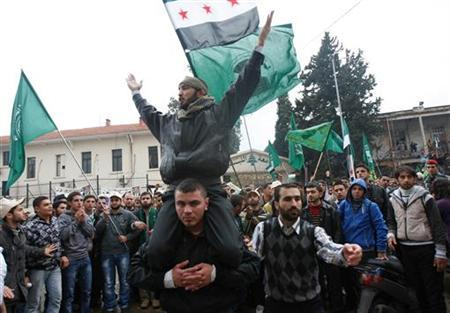 Lebanese students from the Muslim Students Association and some Syrian students chant slogans and wave flags during an protest in solidarity with Syria's anti-government protesters, in the port city of Tripoli, northern Lebanon, December 21, 2011. REUTERS/Omar Ibrahim