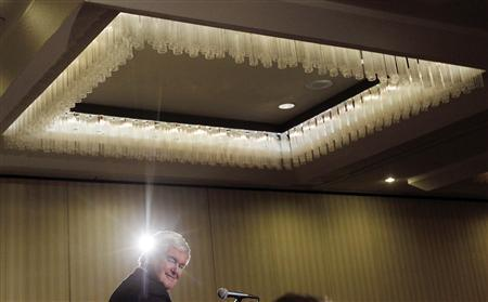 Newt Gingrich looks over his shoulder during a campaign event in Manchester, New Hampshire December 21, 2011. REUTERS/Jessica Rinaldi