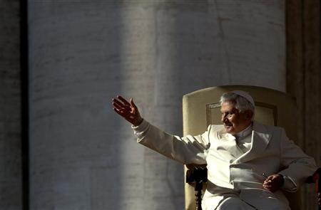 Pope Benedict XVI waves as he leads his weekly audience in Saint Peter's Square at the Vatican November 16, 2011. REUTERS/Stefano Rellandini