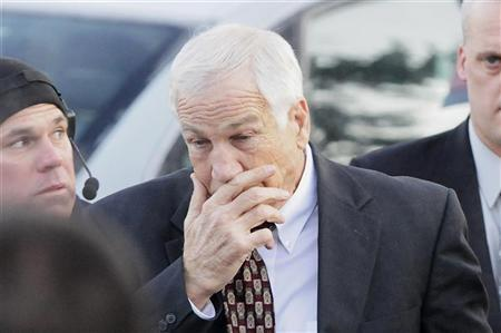Former Penn State assistant football coach Jerry Sandusky arrives for a preliminary hearing to determine if there is enough evidence to hold him for trial on charges of sexually abusing boys, at the Centre County Courthouse in Bellefonte, Pennsylvania, December 13, 2011.  REUTERS/Jonathan Ernst