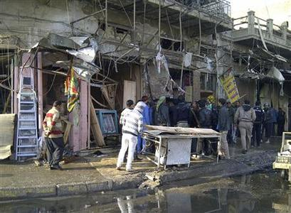 Residents gather at the site of a bomb attack in Alawi district in central Baghdad December 22, 2011.      REUTERS-Saad Shalash
