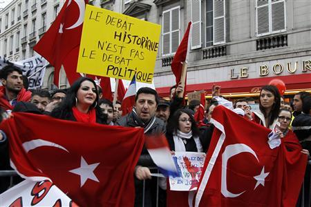 Franco-Turk protesters attend a demonstration next to the National Assembly in Paris December 22, 2011 ahead of a parliamentary vote on a bill that would make it a crime to deny the 1915 mass killing of Armenians by Ottoman Turks was genocide. Tension has risen between Paris and Ankara in the last week over the draft law put forward by UMP party members that will be put to a vote around lunchtime. The slogan reads ''the historical debate is not the political debate''.   REUTERS/Philippe Wojazer